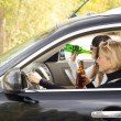 Two women driving a car while drinking — Stock Photo #32087491