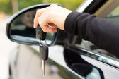 Woman holding the ignition keys of a car — Stock Photo