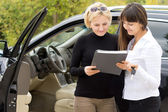 Woman taking delivery of her new car — Stock Photo