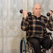 Handicapped senior mworking out — Stock Photo #32825789