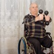 Senior handicapped man exercising — Stock Photo