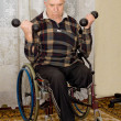 Stock Photo: Senior disabled mexercising with dumbbells