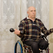 Senior handicapped man doing exercises — Stock Photo
