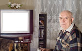Senior man watching television — Stock Photo