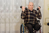 Handicapped senior man working out — Stock Photo