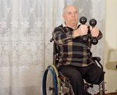 Senior handicapped man exercising — Stock Photo