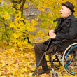 Retired handicapped man in an autumn park — Stock Photo