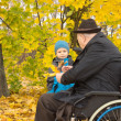 Little boy with his handicapped grandfather — Stock Photo
