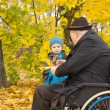 Little boy with his handicapped grandfather — Stock Photo #33814177