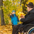 Elderly disabled man playing with his grandson — Stock Photo