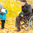 Stock Photo: Youngster showing disabled mtablet-pc