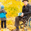 Handicapped senior man and child — Stock Photo