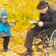 Small boy with his handicapped grandfather — Stock Photo