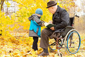 Young child with his disabled grandfather — Stock Photo