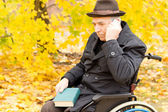 Thoughtful handicapped elderly man — Stock Photo