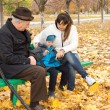 Grandfather, mother and little boy on a park bench — Foto Stock
