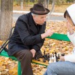 Elderly man arguing during a game of chess — Stock Photo