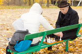 Grandfather playing chess with his daughter — Stock Photo