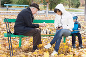Attractive woman playing chess with her father — Stock Photo