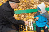 Little boy playing chess with his Grandpa — Stock Photo