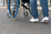Person pushing a wheelchair — Stock Photo