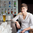 Friendly young man drinking in a bar — Stock Photo