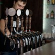 Bartender dispensing draught beer — Stock Photo #35559687