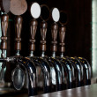 Row of beer taps on stainless steel keg in pub — Stock Photo #35559691