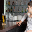 Young man being served a pint of beer — Stock Photo