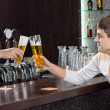 Stock Photo: Friends toasting as they enjoy a pint of beer