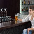 Man drinking beer alone on a pub — Stock Photo #35559711