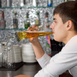 Young man drinking a pint of draught beer — Stock Photo