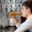 Young man drinking a pint of draught beer — Stock Photo #35559735