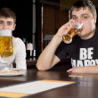 Two men on a boys night out drinking beer — Foto de Stock