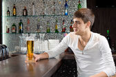 Young man enjoying a relaxing evening at the pub — Stock Photo