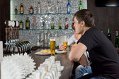 Two guys drinking at a bar — Stock Photo