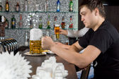 Man seated at the bar with a large tankard of beer — Stock Photo