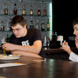 Stock Photo: Two men friends having a drink at the bar