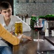 Young man chatting to his girlfriend at the bar — Stock Photo