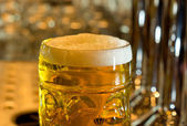 Beer mug filled with cold foamy beer — Stock Photo