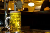 Glowing tankard of golden draught beer — Stock Photo