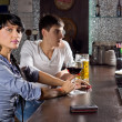 Two young friends drinking at the pub — Stock Photo