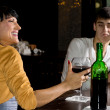 Optimistic womdrinking red wine at bar — Stock Photo #36238203