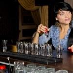 Woman drinking vodka shots at a bar — Stock Photo #36238293