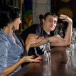 Young man and woman disputing the last drink — Stock Photo