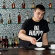 Caucasibarmserving coffee at bar — Stock Photo #36238415