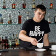 Stock Photo: Caucasibarmserving coffee at bar