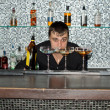 Barman keeping an eye on the cocktails — Stock Photo