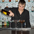 Barman pouring drinks at a bar — Stock Photo