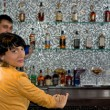 Attractive woman sitting at a bar counter — Stock Photo